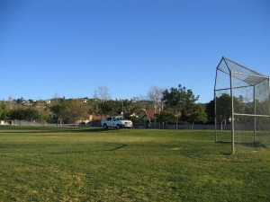 truck spraying lawn at a school, weeds, plant care, plant disease