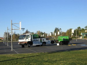 truck on black top at school, lawn care, weeds, spraying lawn, pest control